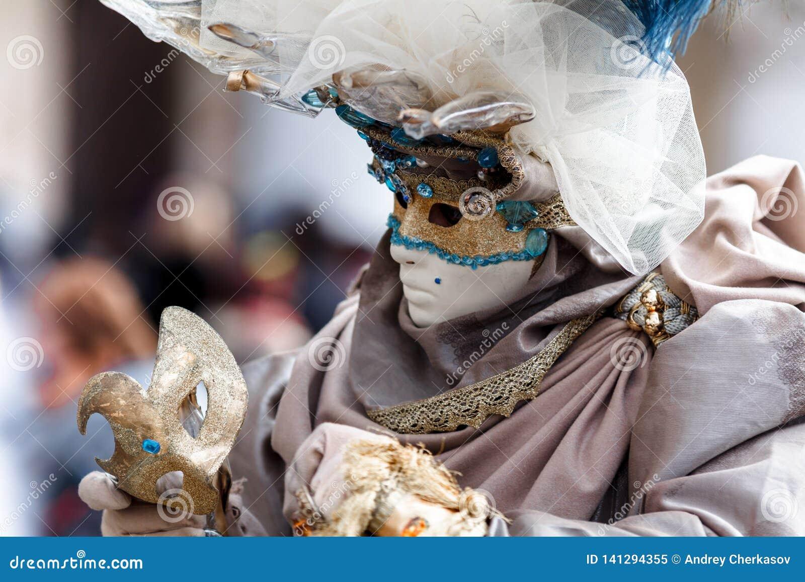 Venezia carnival art artist dress suit beauty mask face mistery sorrow