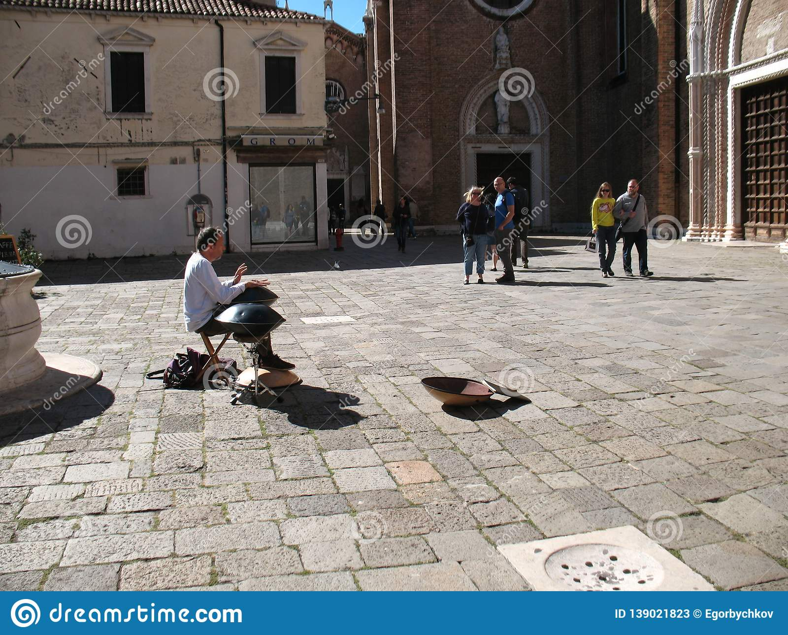 Venezia, Italy - October 04, 2016: Musician entertaining tourists