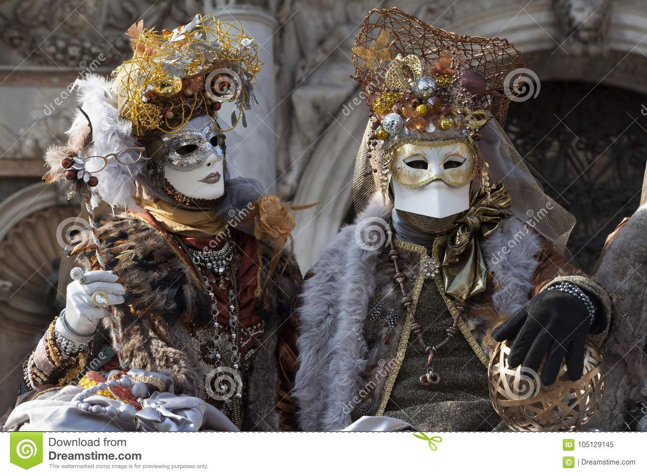 Venice Carnival Figures In A Colorful Gold And Brown