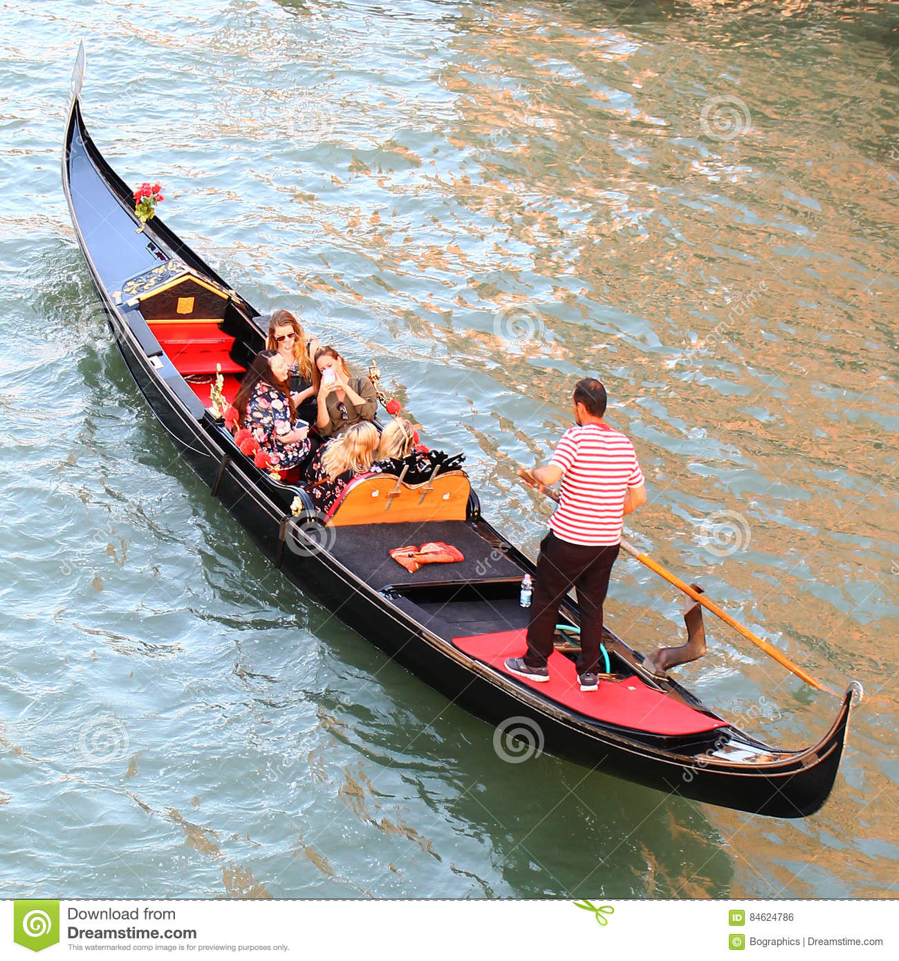 Venice gondola on water with people, from top