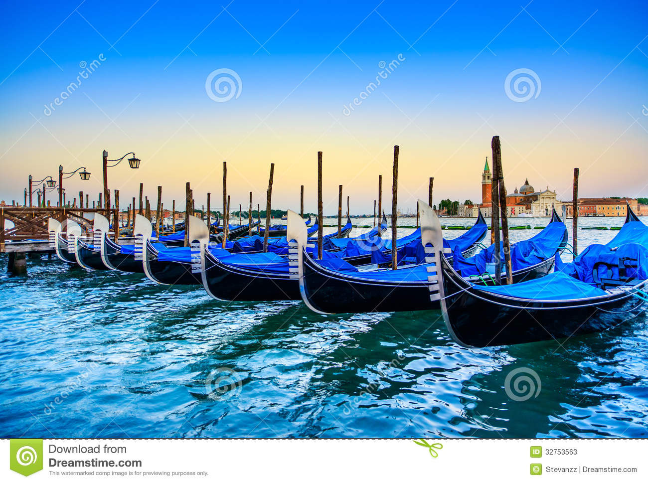 Venice Gondolas Or Gondole On Sunset And Church