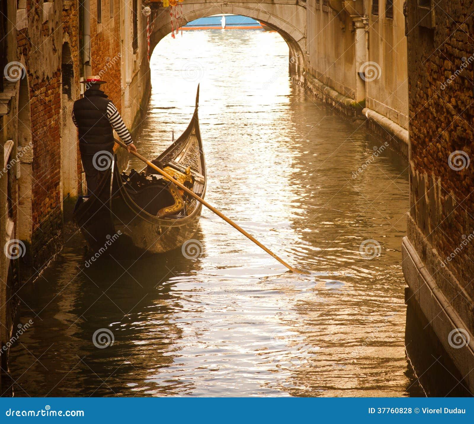 Venice gondolier in sunset