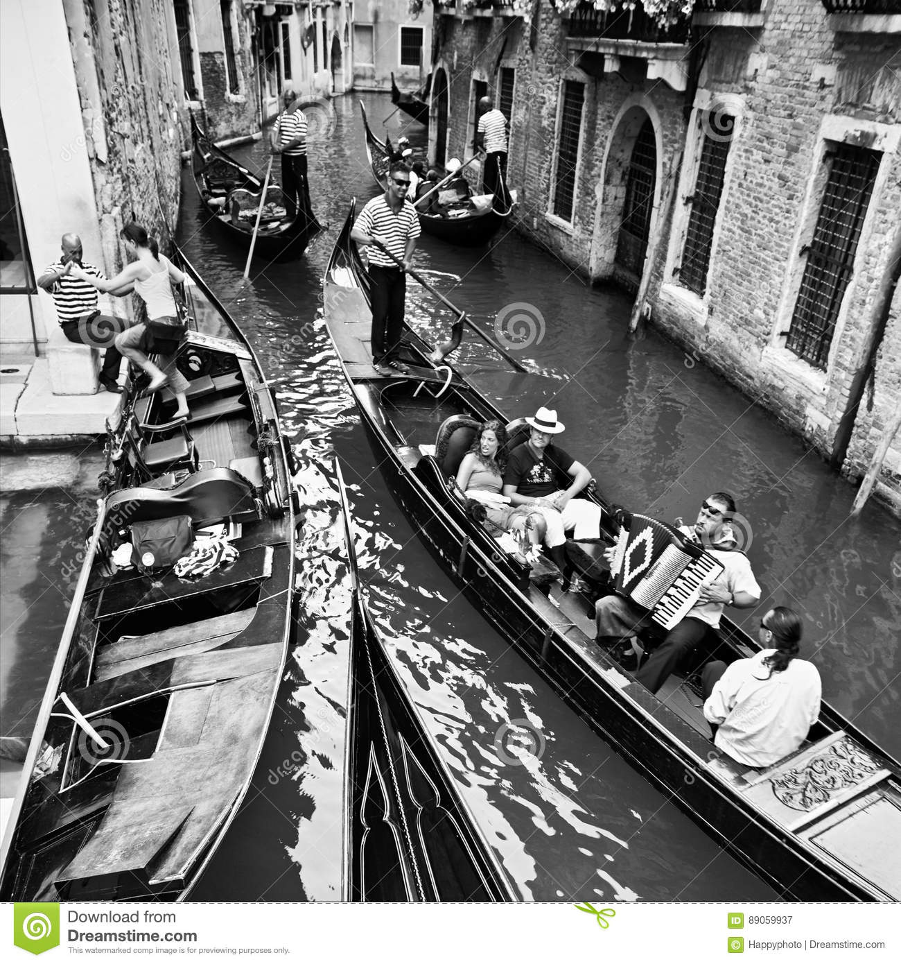 Venice, Italy - June 30, 2009: Life in Venice, travelling by gondolas with gondoliers, black and white photo.
