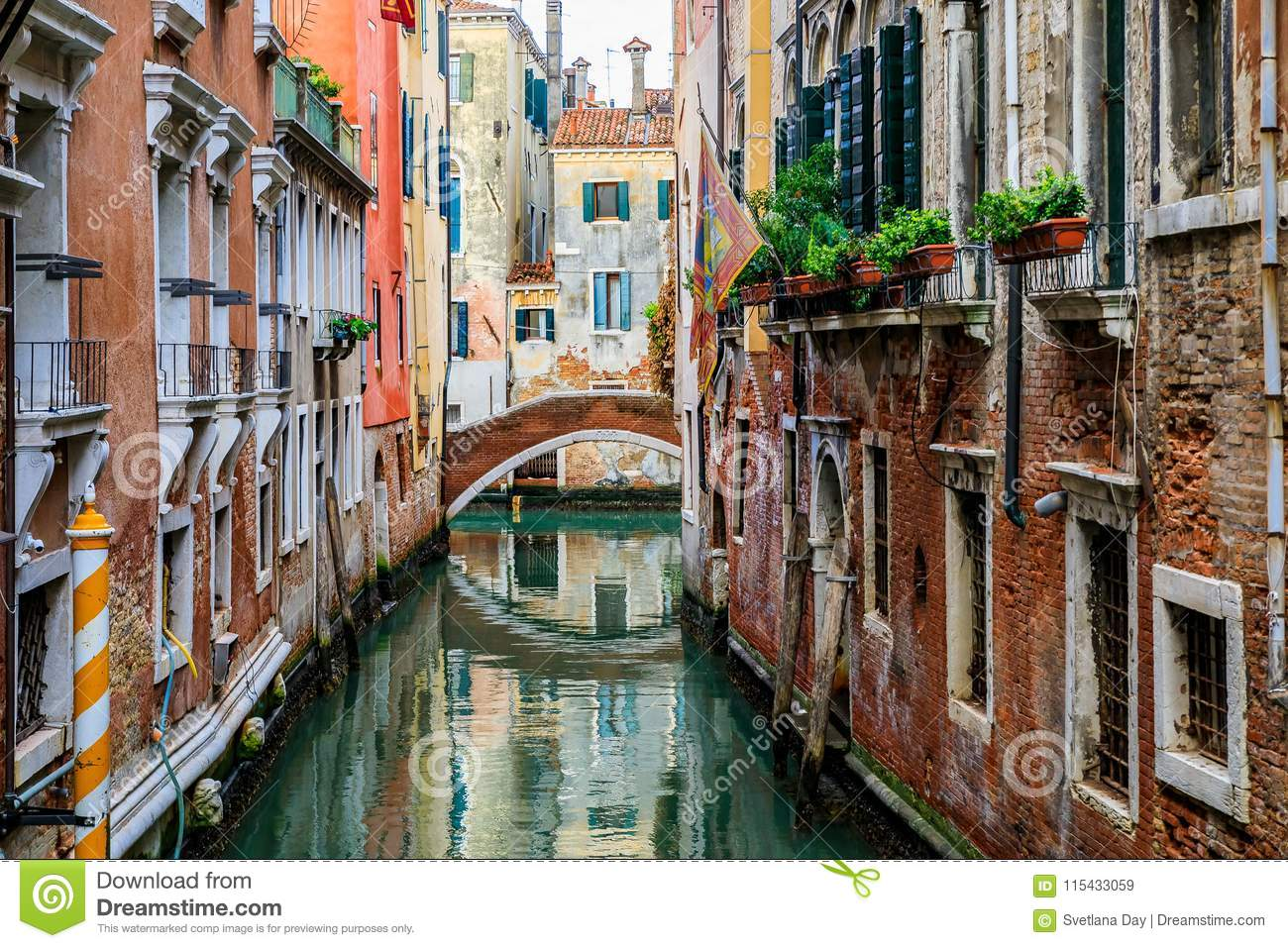 Weathered building facade on a picturesque canal in Venice Italy
