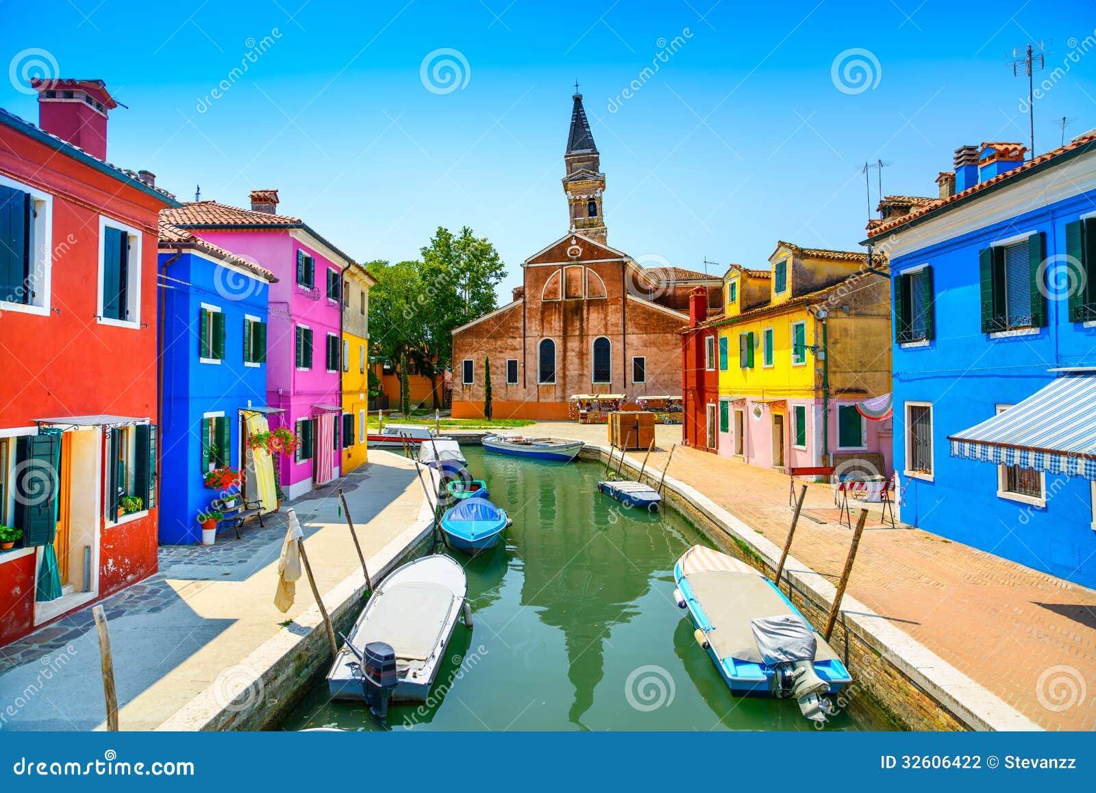 Venice landmark, Burano island canal, colorful houses, church and boats, Italy