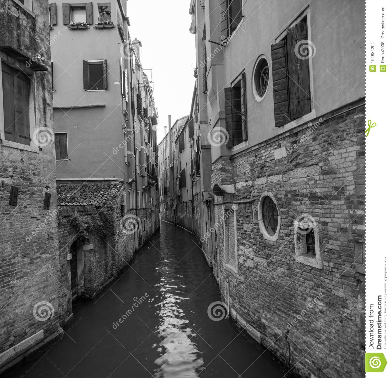 Venice traditional canal surrounded by old architecture black and white