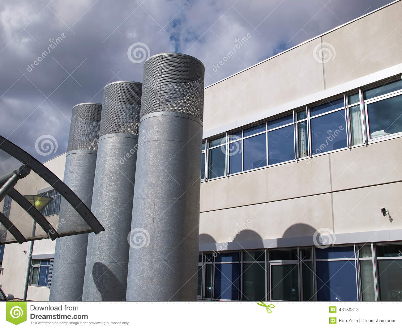 Industrial Building Ventiltors : Ventilation pipes of industrial building stock photo