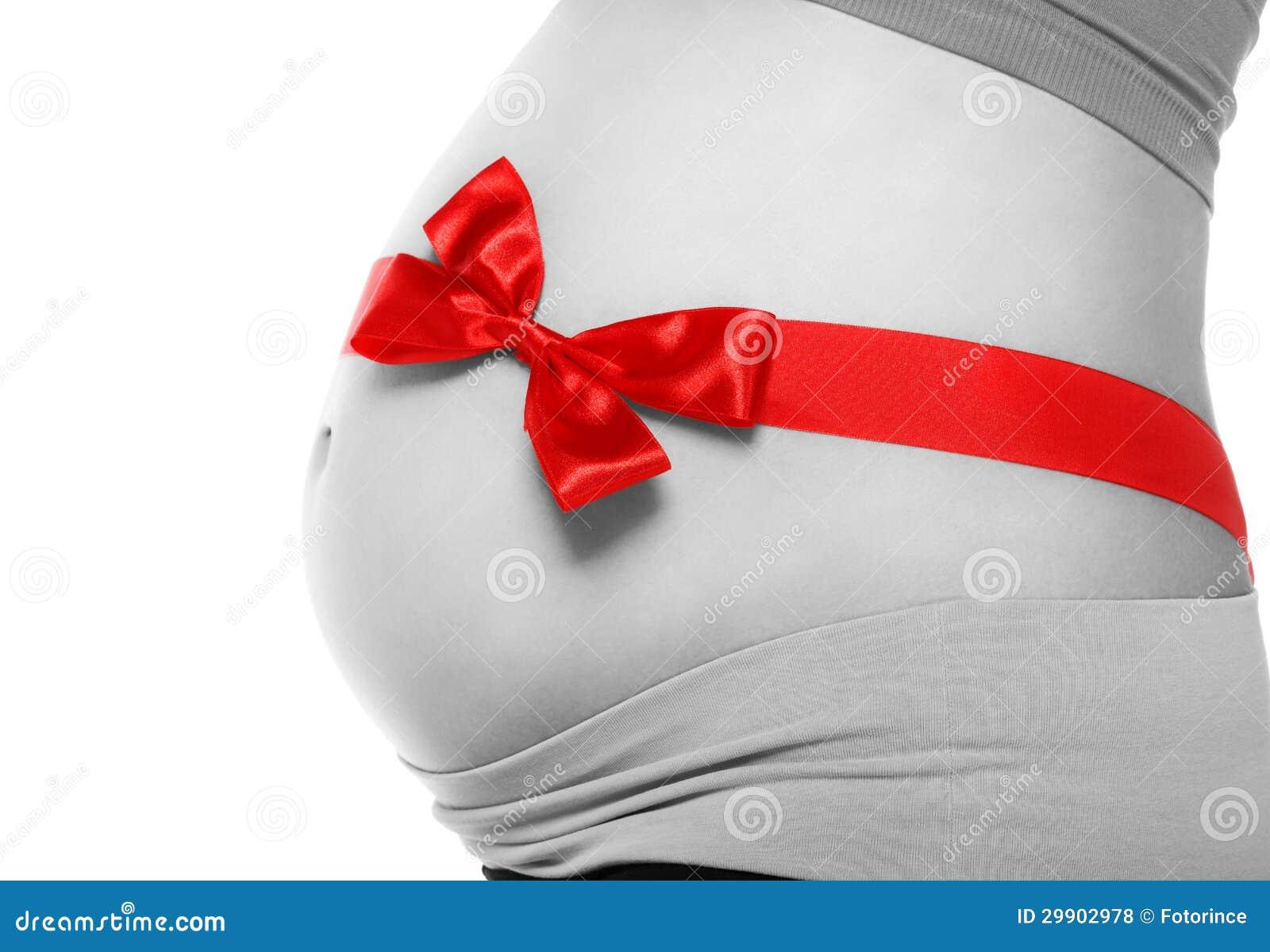 ventre d 39 une femme enceinte attach e avec un arc rouge photos libres de droits image 29902978. Black Bedroom Furniture Sets. Home Design Ideas