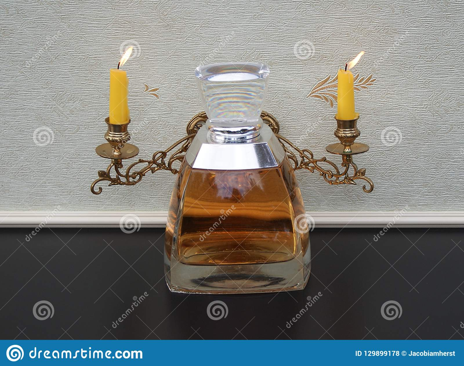 Vera Wang Fragrance For Ladies Large Perfume Bottle In Front Of A Piano Candelabra With Shining Candles Stock Photo Image Of Life Intense 129899178