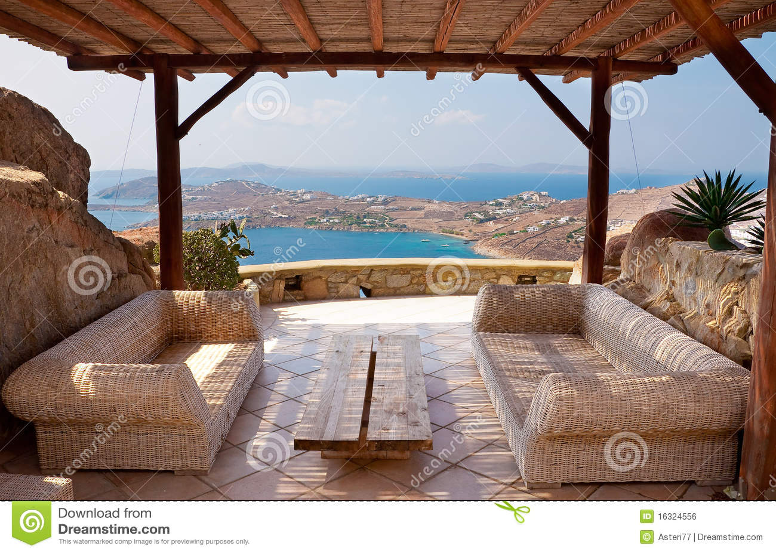 Veranda with wicker furniture in a hotel royalty free - Sofas de mimbre ...