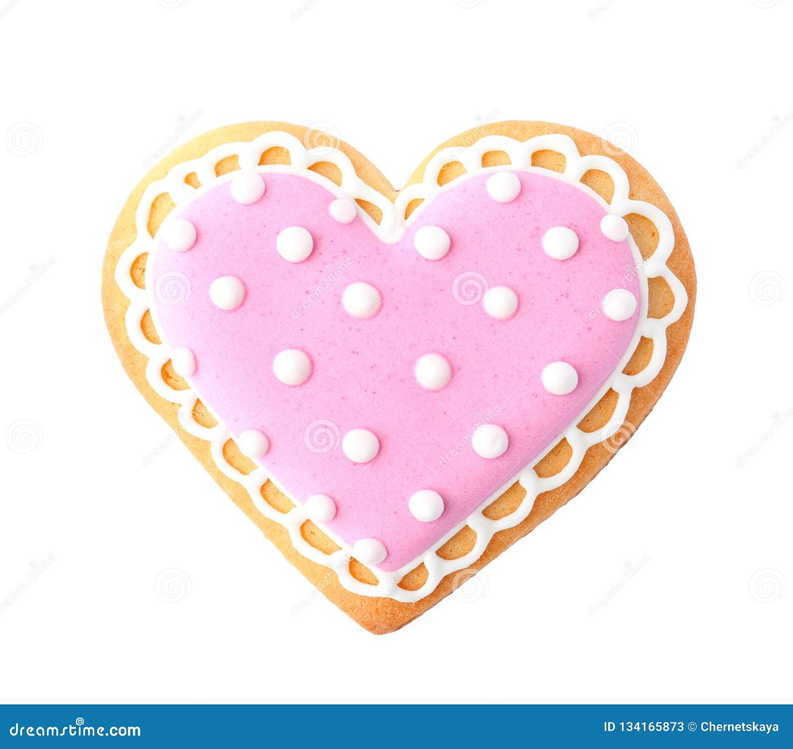 Verfraaid hart gevormd koekje op witte achtergrond