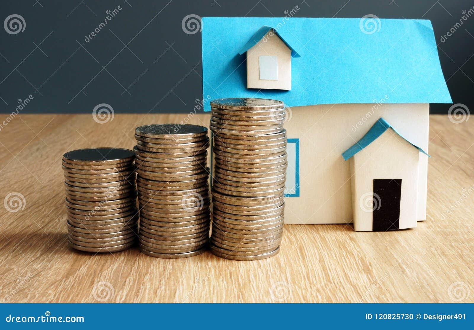 Vermögenswert Modell des Hauses und der Münzen