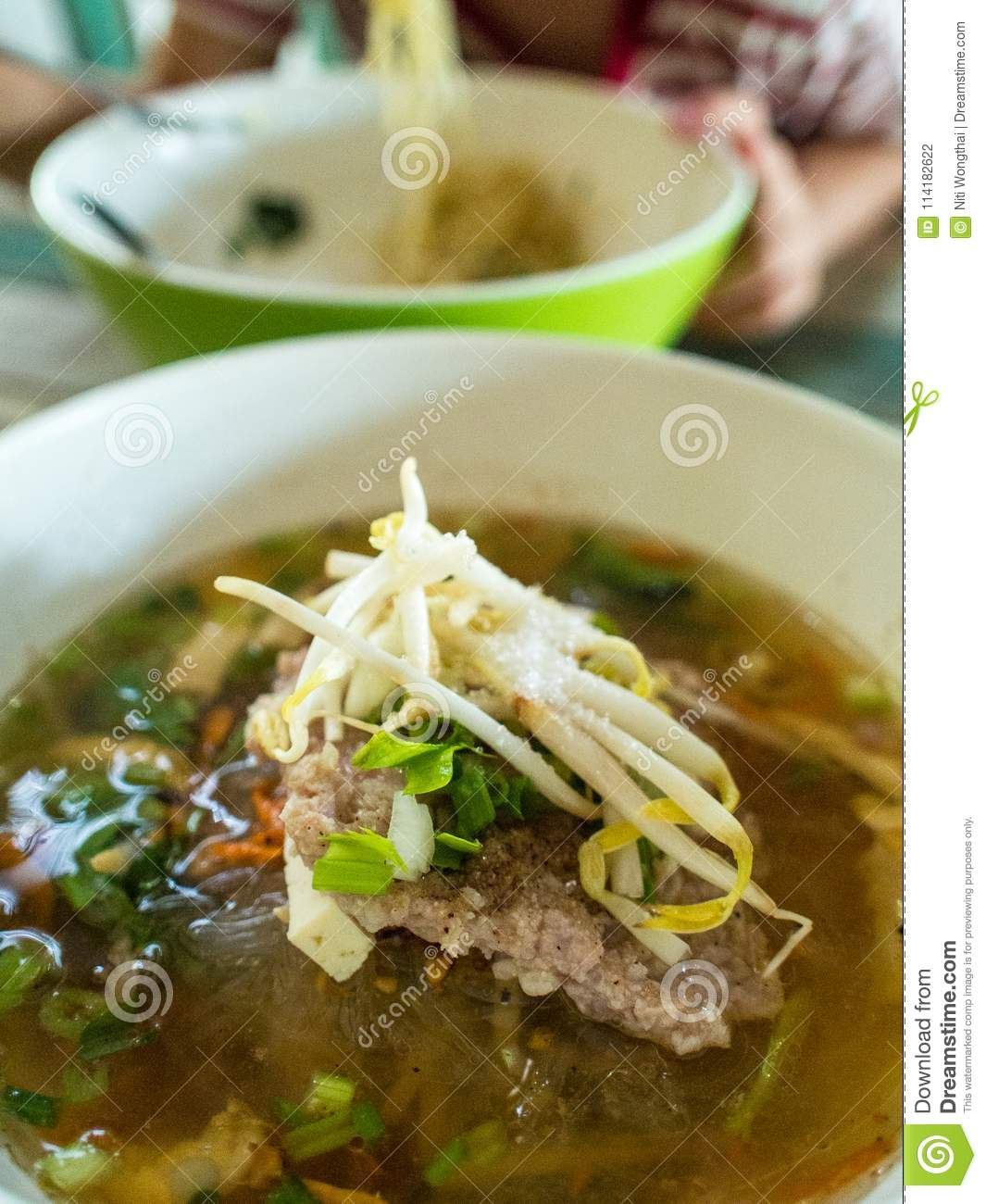 Vermicelli noodle soup with pork and vegetables in traditional r