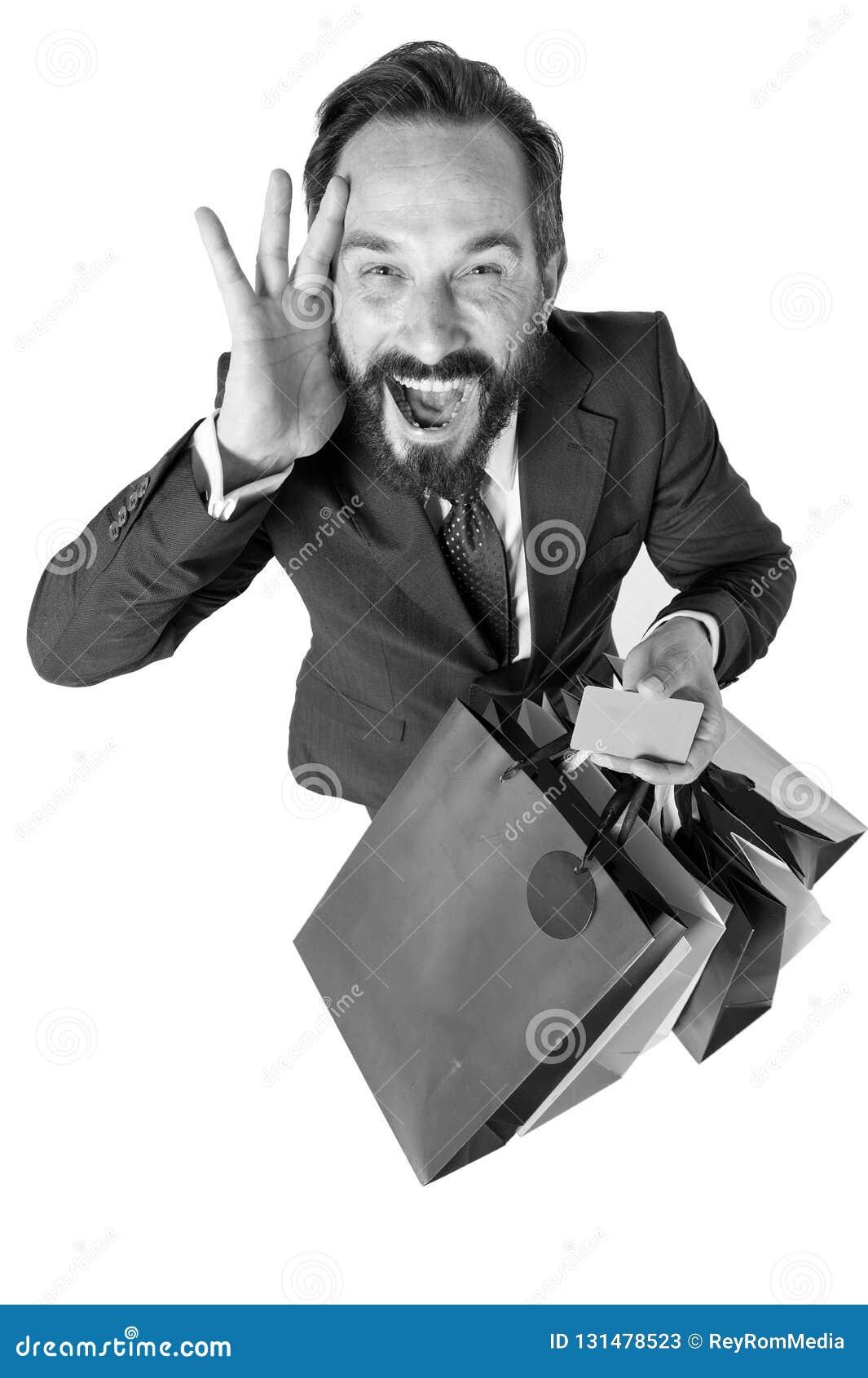 Verrückte Rabattzeit für den Einkauf Überraschter Verkaufszeitraum Attraktiver Geschäftsmann mit Einkaufstasche und Kreditkarte i