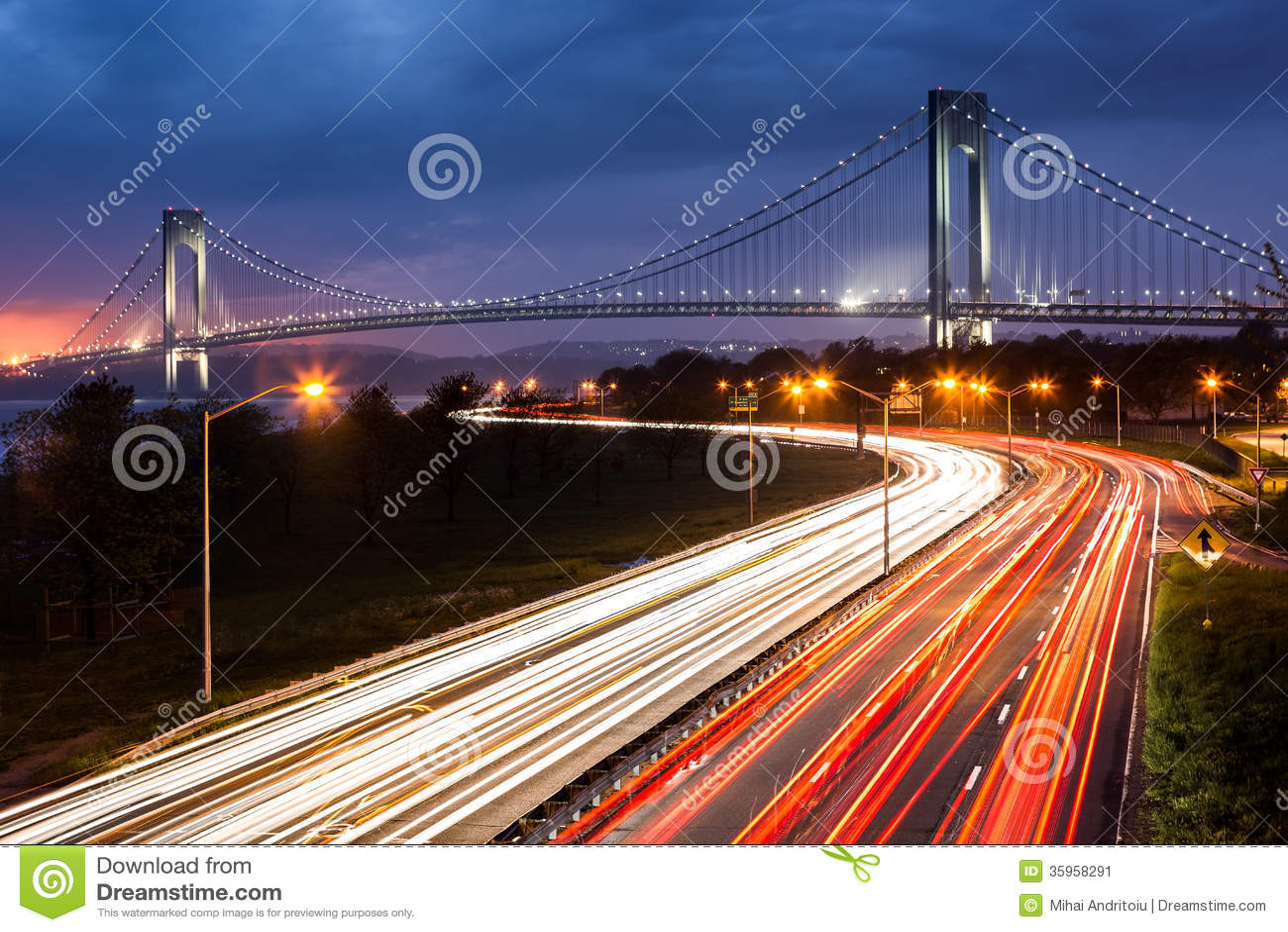 Verrazano Narrows Bridge above the light trails of the Belt Parkway traffic.