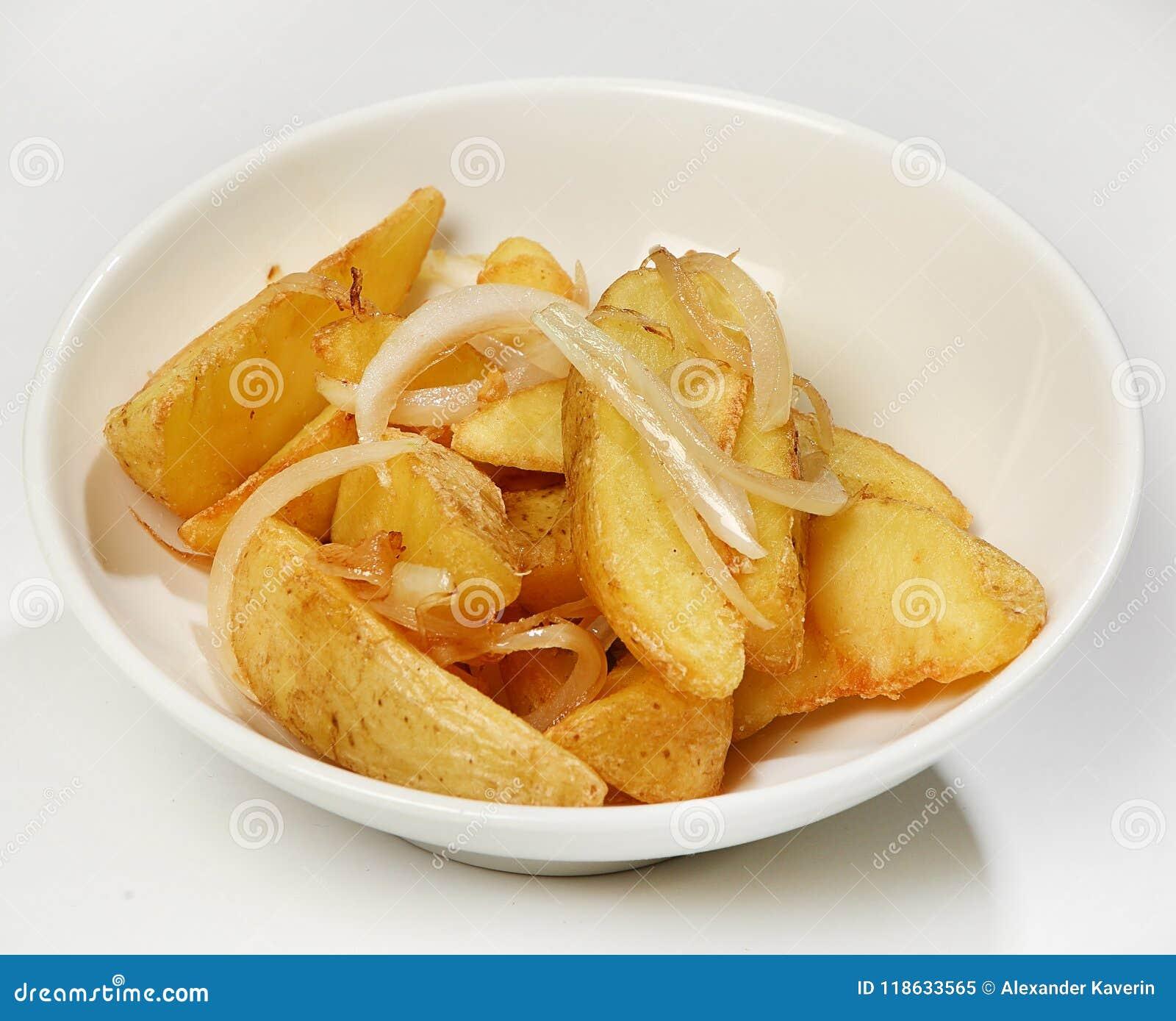 Versier van Aardappelplakken met uien, close-up