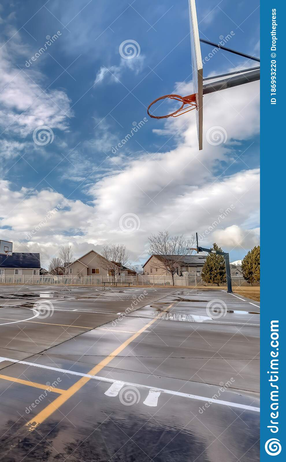 Vertical Basketball Courts On Neighborhood Park With Houses And Playground In Background Stock Photo Image Of Grassy Sports 186993220