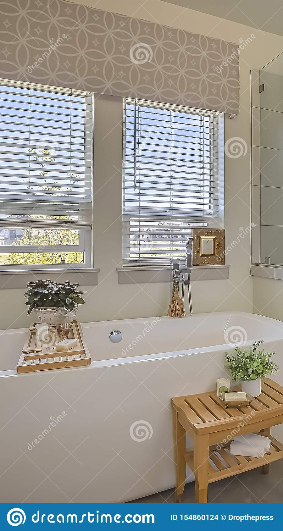 Vertical Bathtub And Shower Stall In Front Of Windows With Valance And Blinds Stock Photo Image Of Indoor Bathtub 154860124