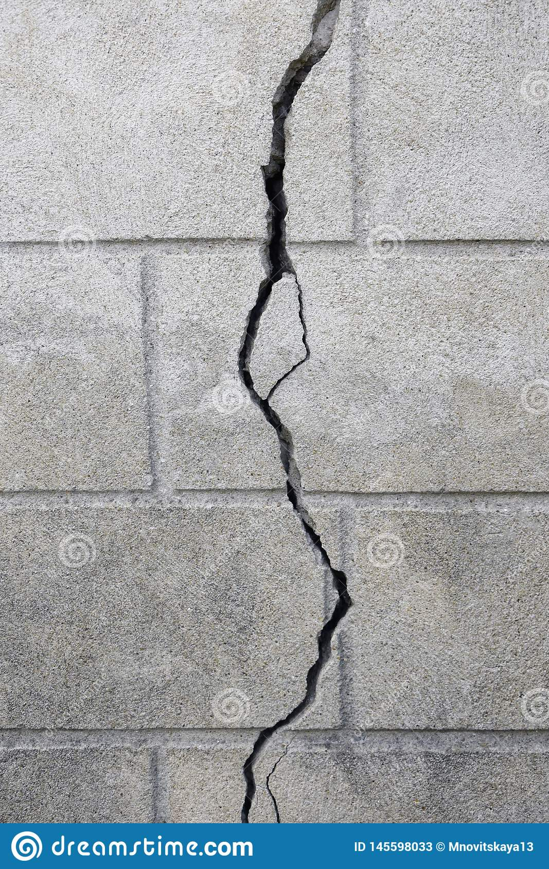 Vertical bigcrack on old brick wall