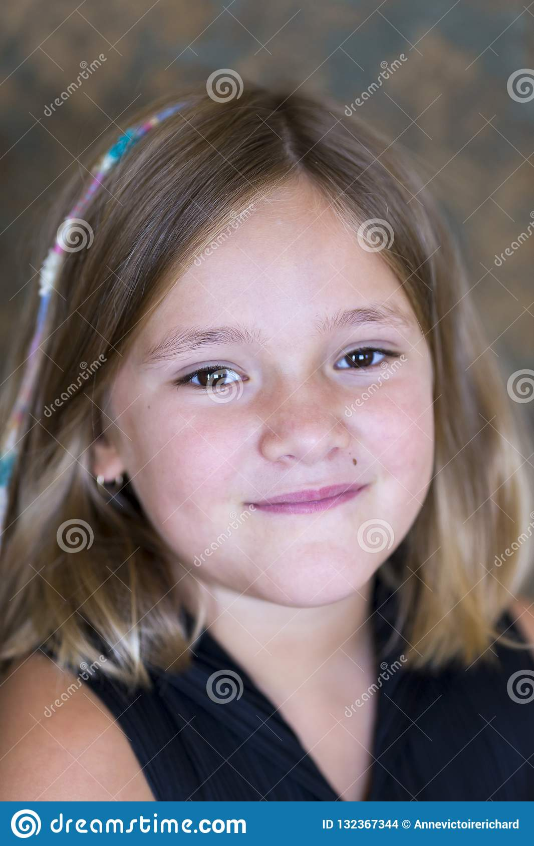 Vertical Closeup Of Beautiful Little Girl In Black With Shoulder Length Bobbed Hair Stock Photo Image Of Closeup Glowing 132367344