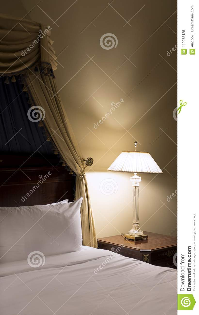 Download Bedroom Corner With Old Fashioned Bed With Victorian Canopy And  Lamp With Dim Light