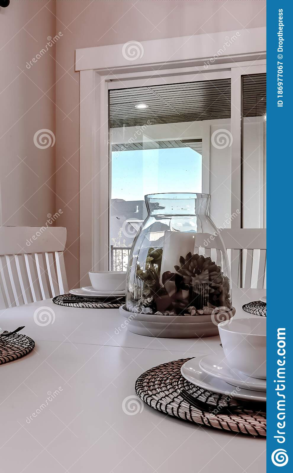 Vertical Dining Table With Chairs And Tableware Arranged Around A Decorative Centerpiece Stock Image Image Of Snow Knife 186977067