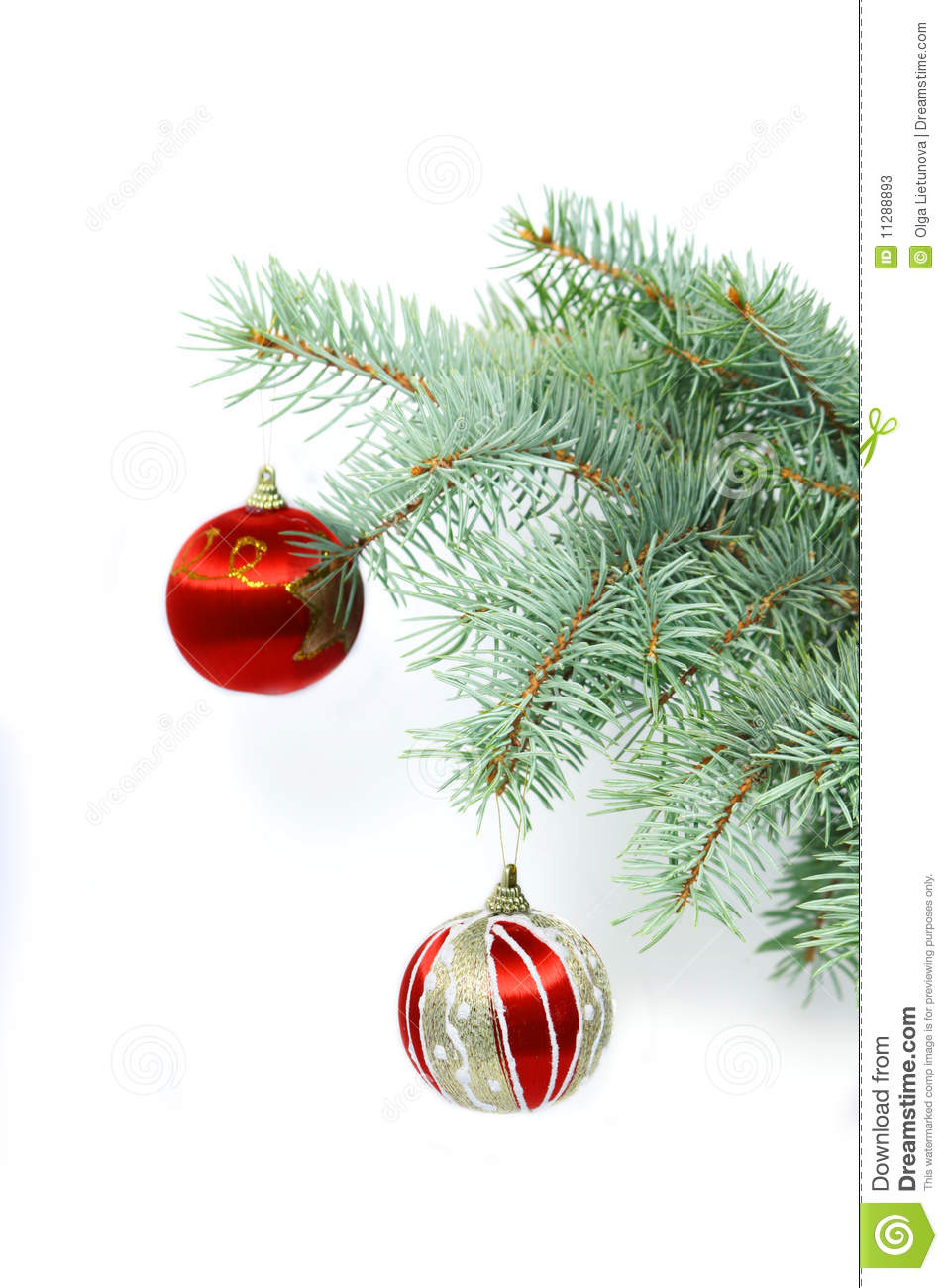 Vertical fir tree branch with christmas decoration stock