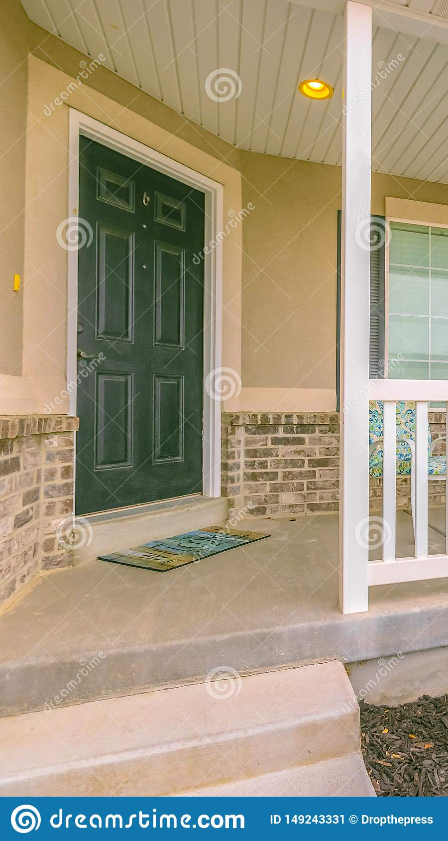 Vertical Frame Home Facade With Yard And Stairs In Front Of The Small Porch With Furniture Stock Image Image Of Entry Door 149243331