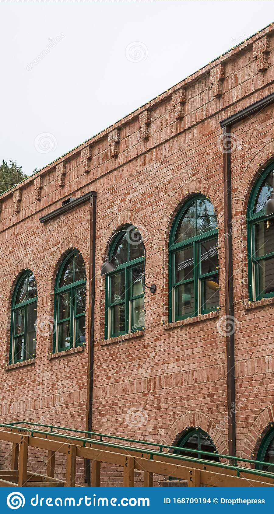 Vertical Frame Restaurant Exterior In Park City With Red Brick Wall And Green Arched Windows Stock Photo Image Of Clouds Snow 168709194