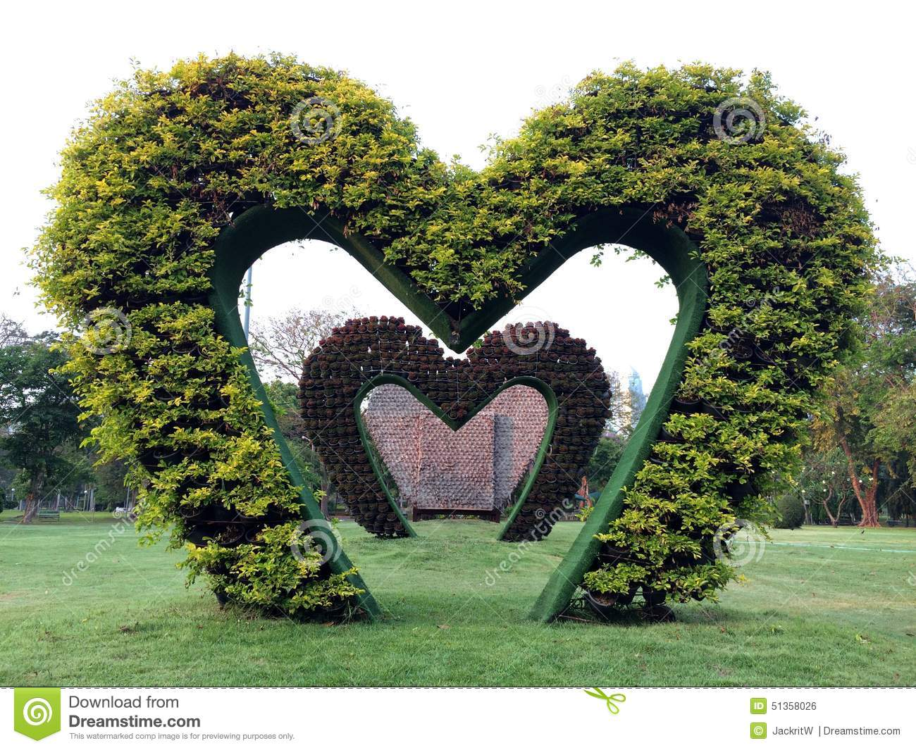 Vertical garden in heart shape with white space on top stock photo