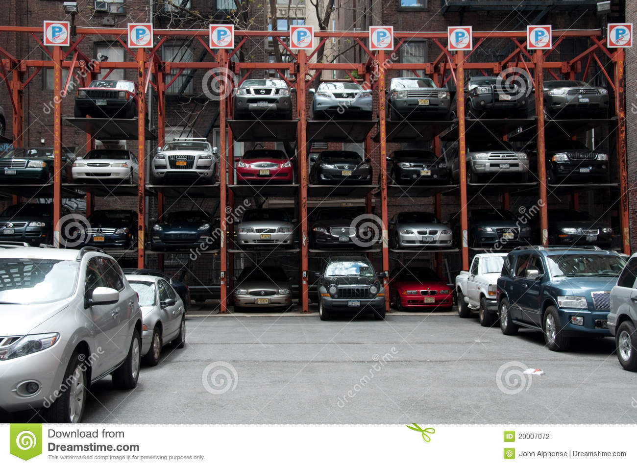 Vertical hydraulic parking spaces new york city editorial for Parking garages new york city