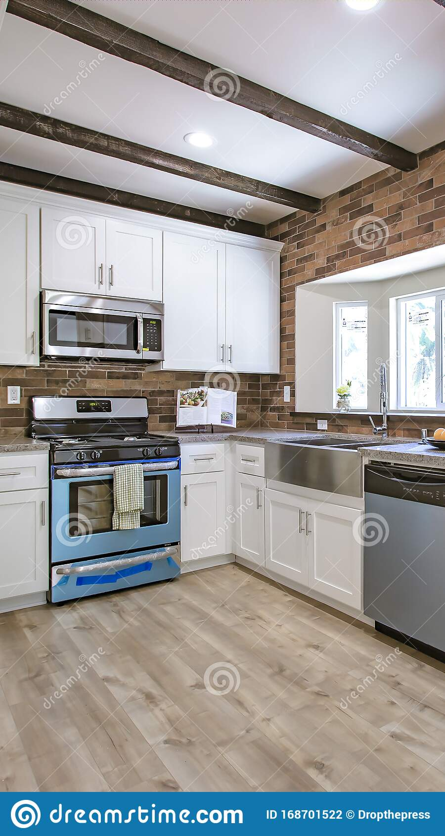 - Vertical Kitchen With Brick Backsplash And Counter Spcae Stock