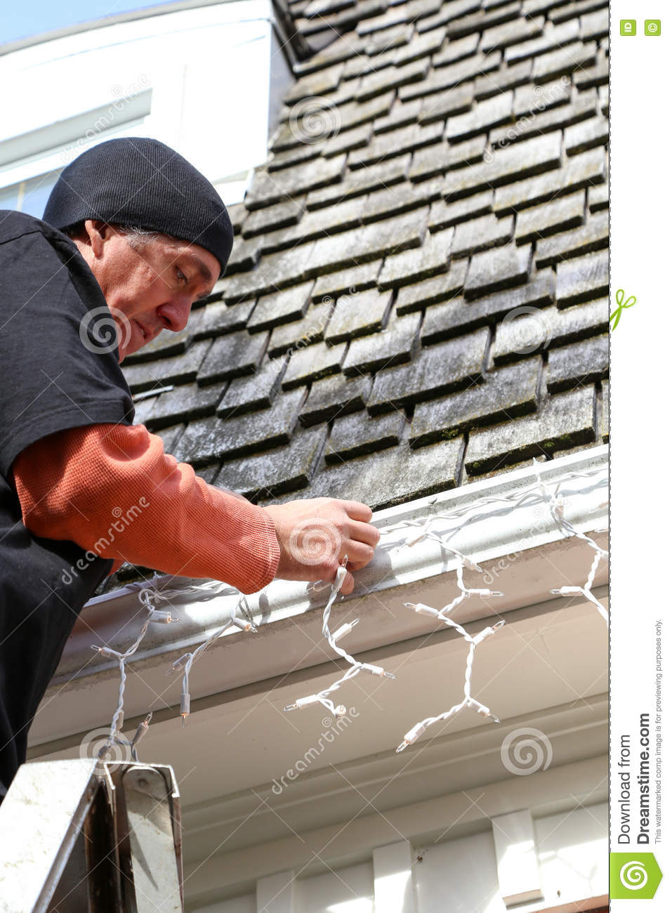 What Can I Use To Attach Christmas Lights To Brick vertical man on ladder hanging christmas lights stock image