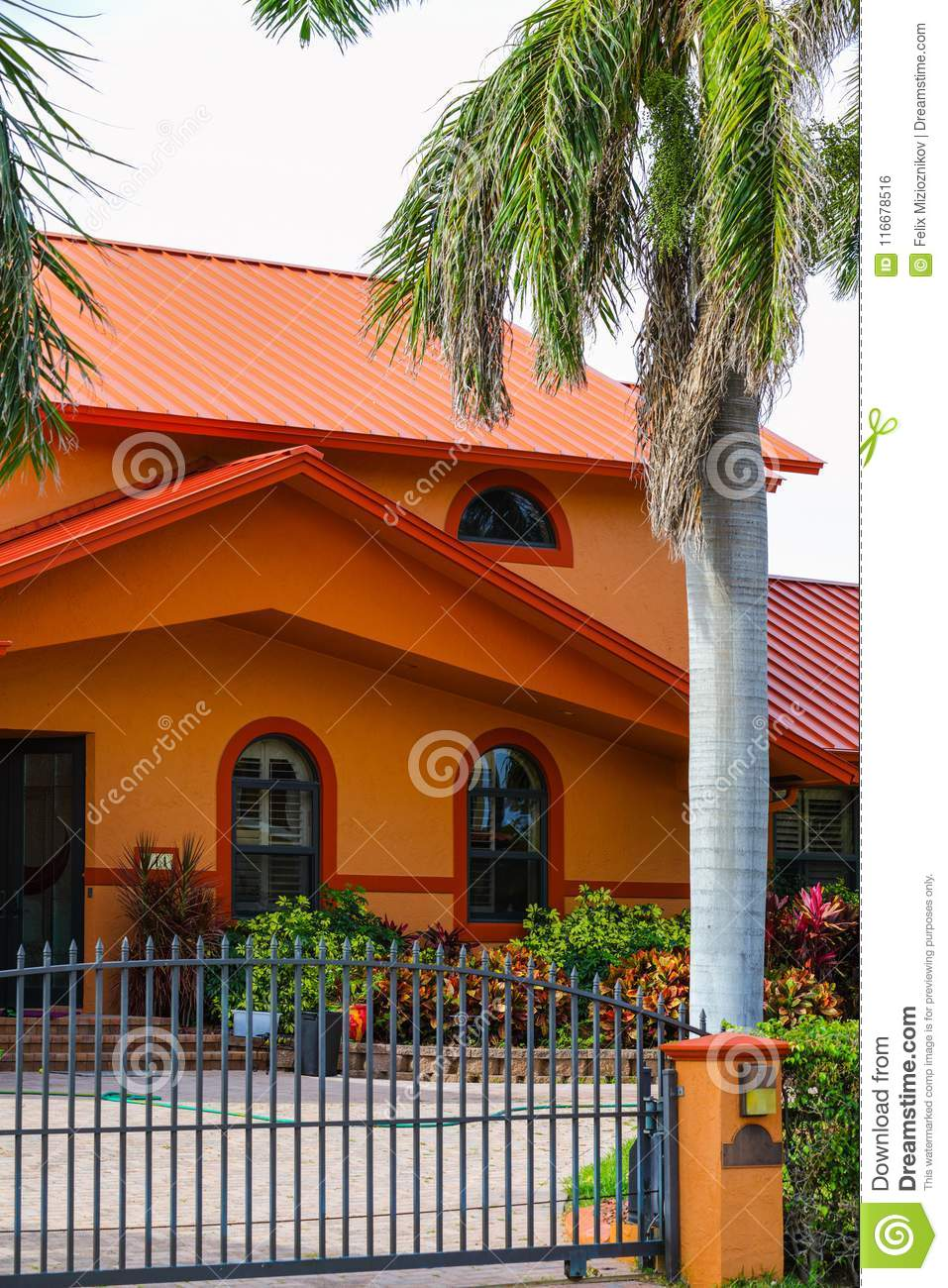 Vertical photo typical South Florida house with security fence a