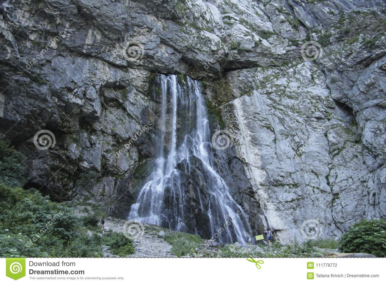 Vertical picturesque natural landscape mountain waterfall