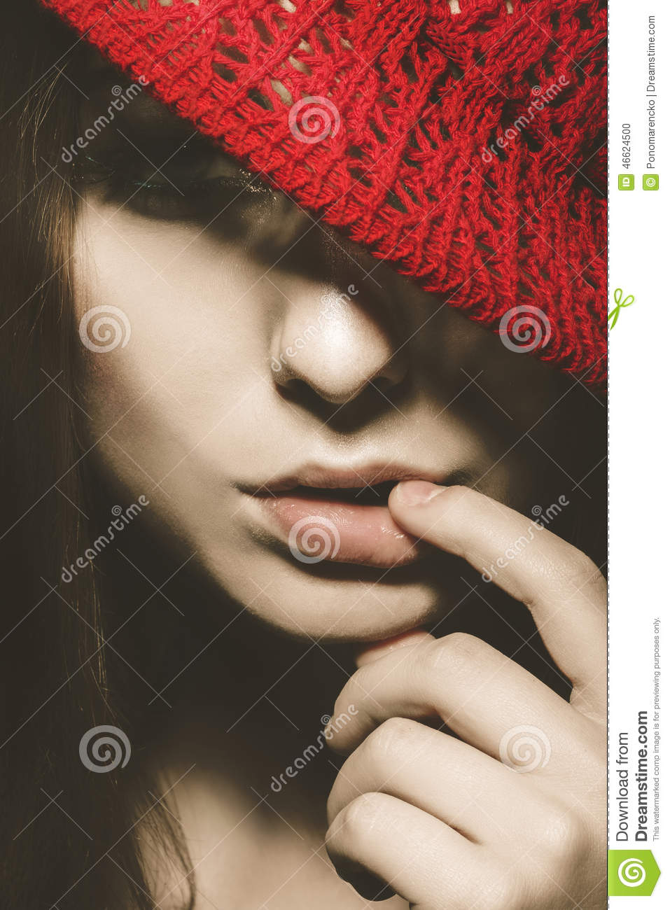 Vertical Portrait Of Cute Woman With Red Hat And Finger