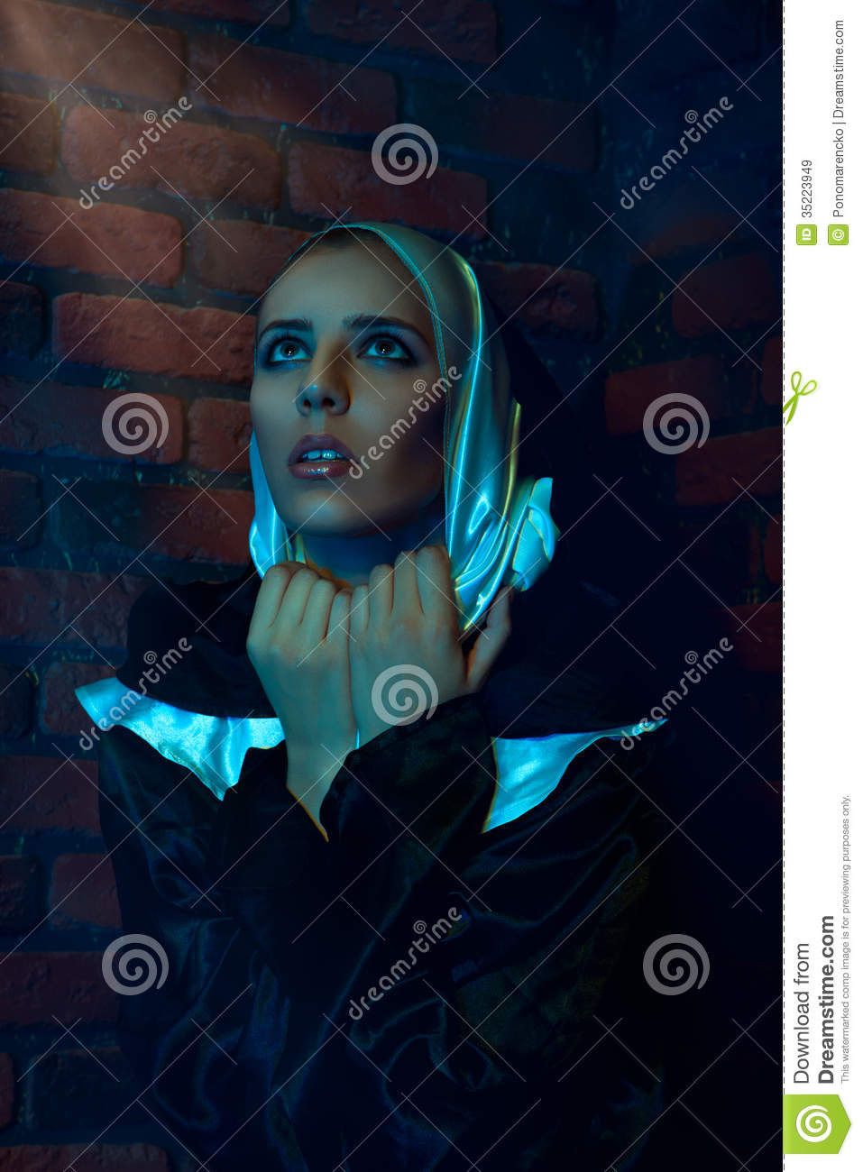 Vertical Portrait Of Nun Nera Brick Wall Royalty Free