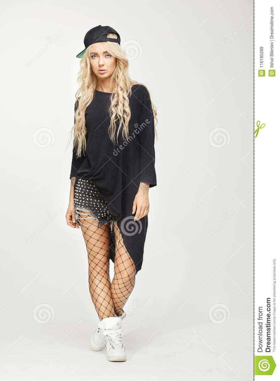 Vertical Portrait Of Swag Girl In Stylish Clothes With Cap