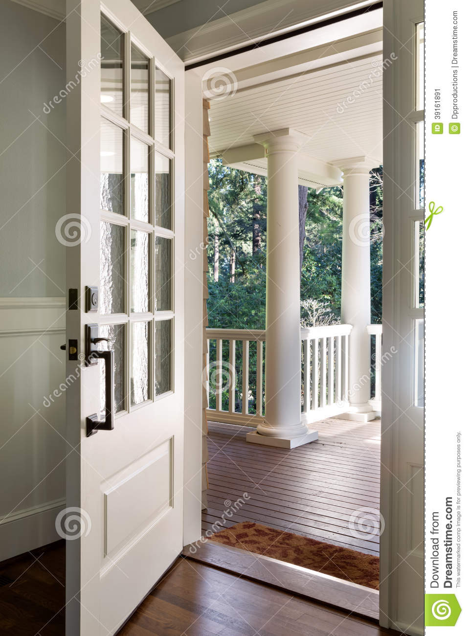 Vertical shot of an open wooden front door stock image for Entry door with window that opens