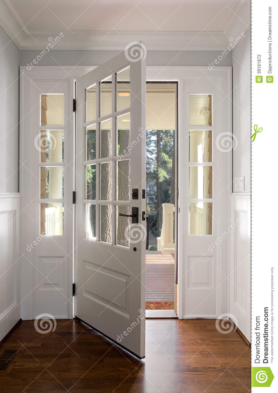 Vertical Shot Of An Open Wooden Front Door Stock Photo