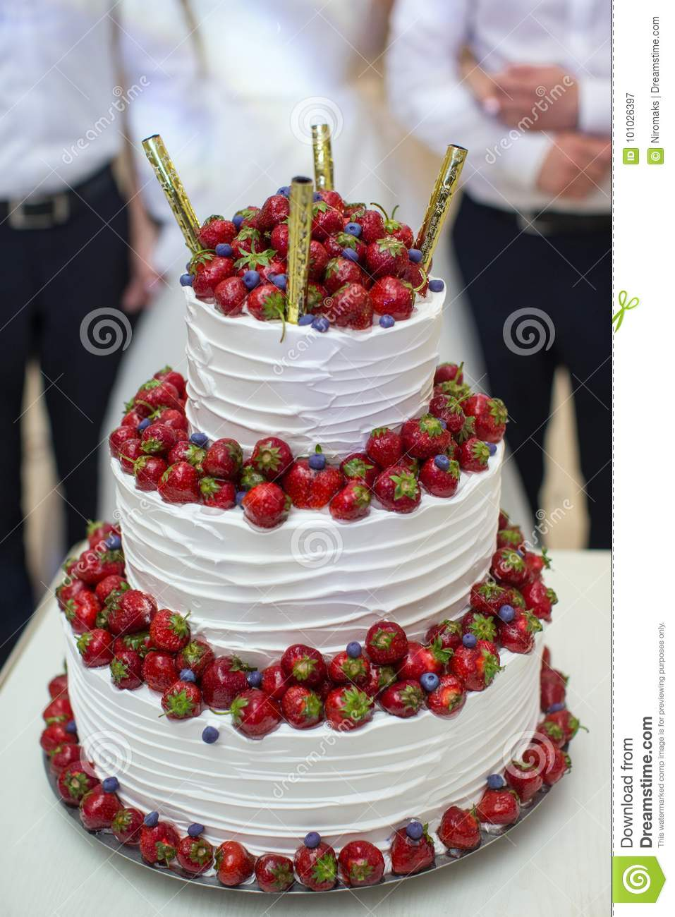 Vertical Shot Of A Red And White Wedding Cake With Fresh