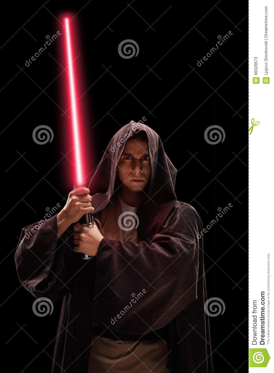 Vertical shot of a warrior with laser sword
