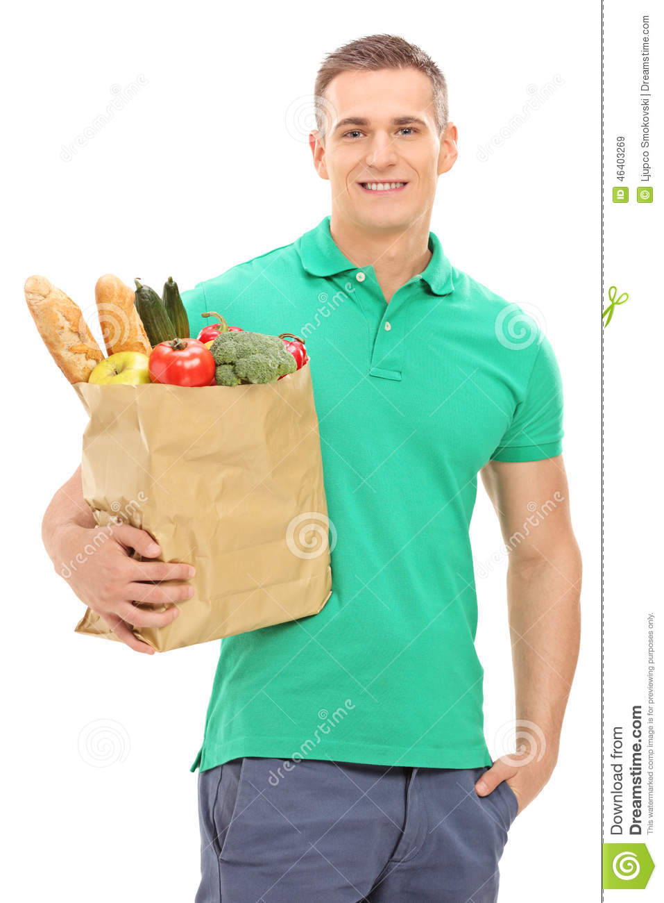 vertical shot of a young man holding a grocery bag stock photo   image 46403269