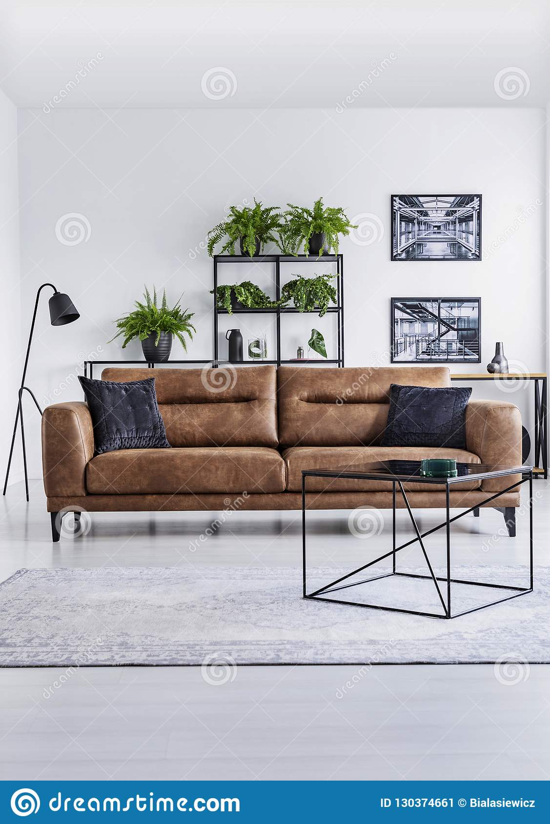Picture of: Vertical View Of Luxury Home Interior Brown Leather Sofa With Brown Pillows In The Middle Shelf Stock Image Image Of Relax Condo 130374661