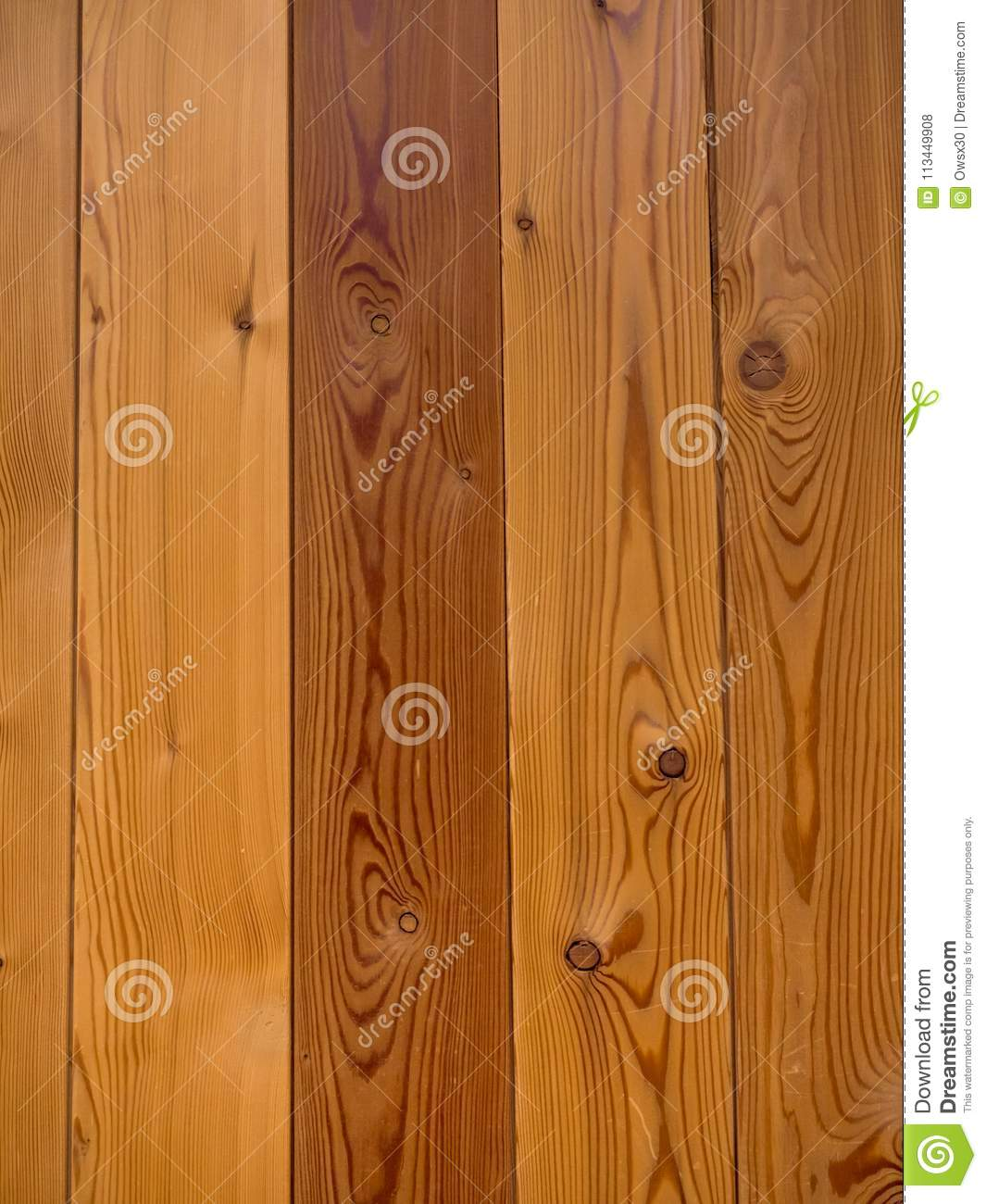 Vertical Wall Of Pine Boards In The Background Stock Photo