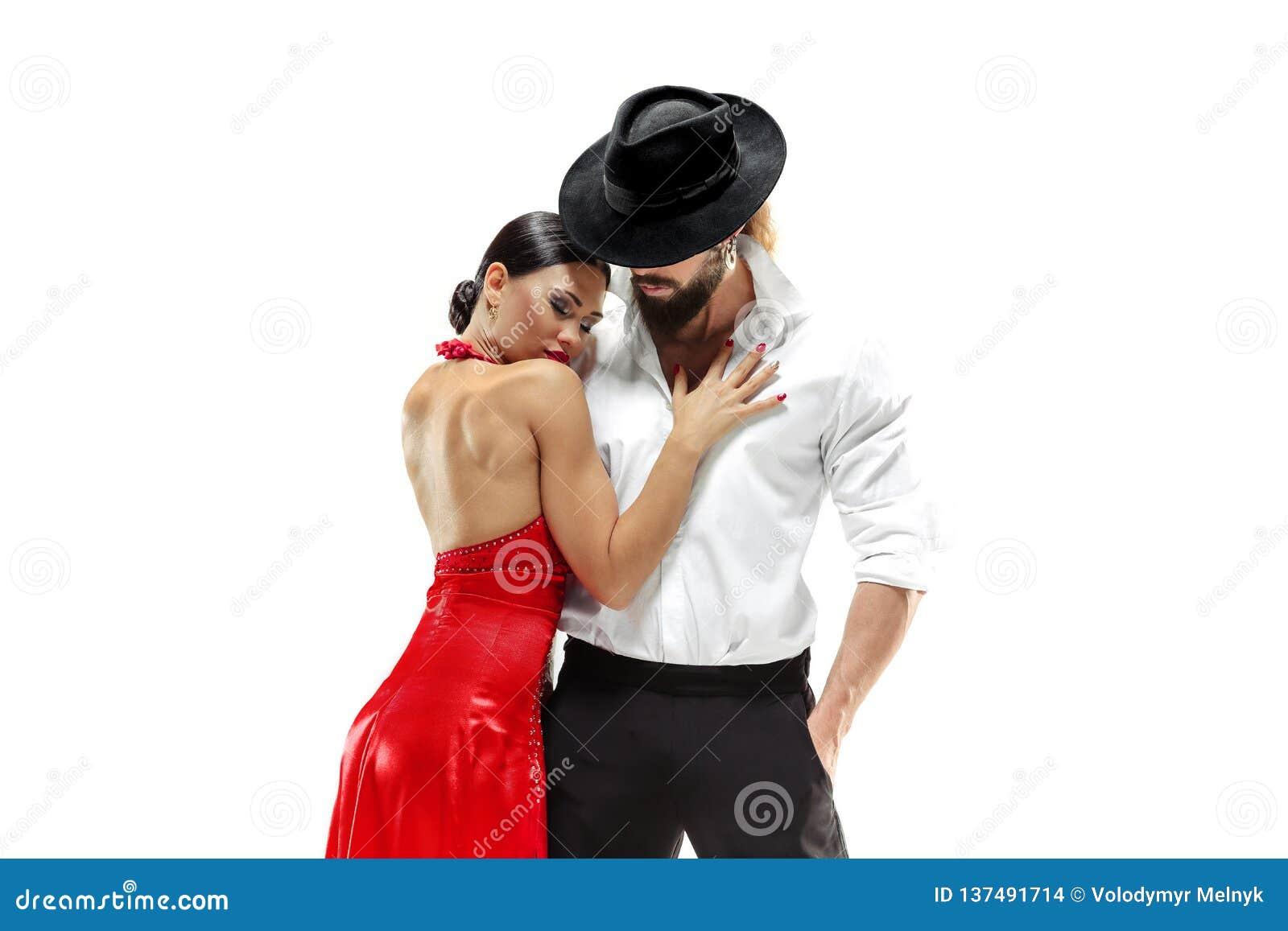Verticale de jeunes danseurs de tango d élégance D isolement au-dessus du fond blanc