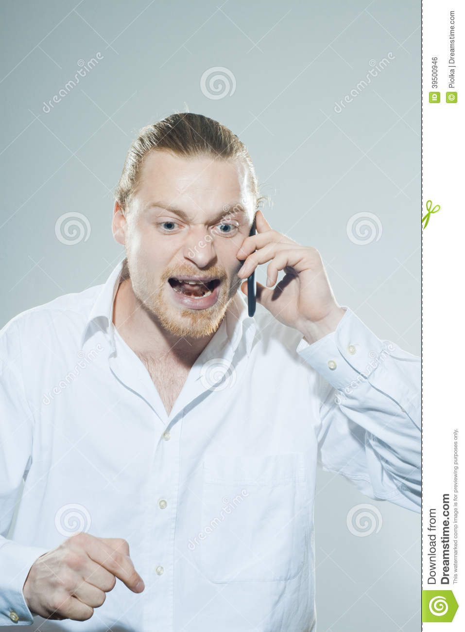 Very angry man on telepone