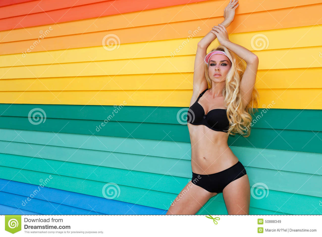 Very beautiful woman in the fantastic colourful dress on the colourful background from boards