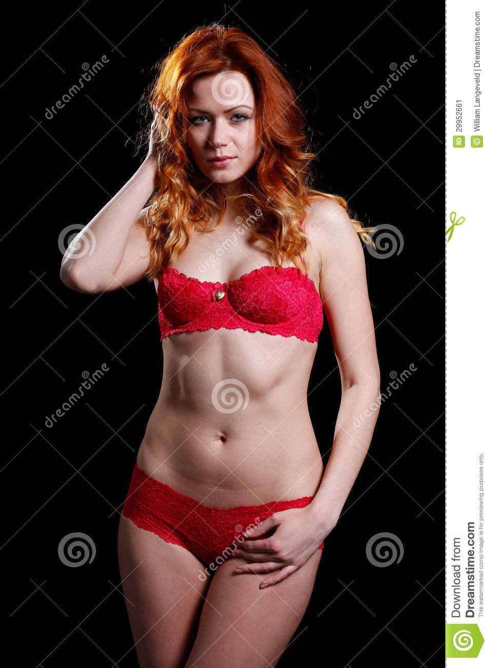 very beautiful woman with red hair in red lingerie stock