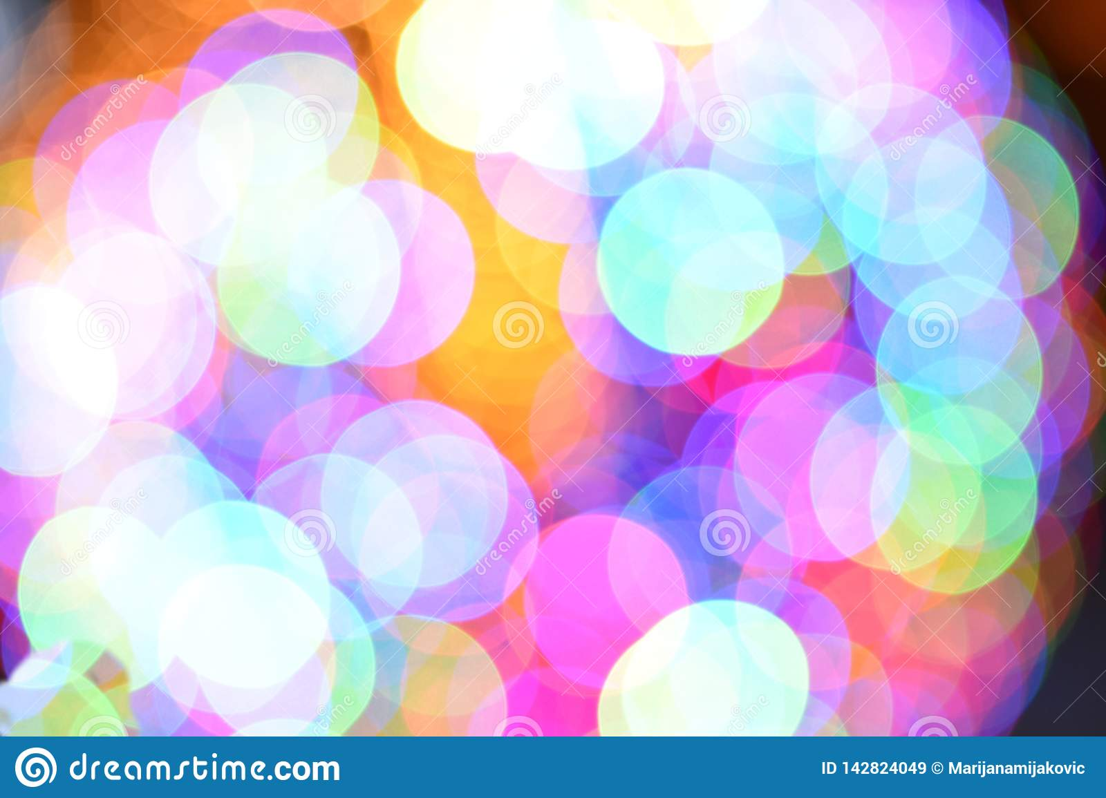 Very bright colorful light blue and pink bokeh background